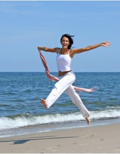 happy-woman-beachinwhitepants