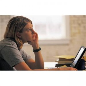 Woman With Laptop Looking Worried